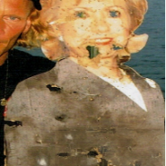 Hillary Clinton image shot full of bullets at family event.